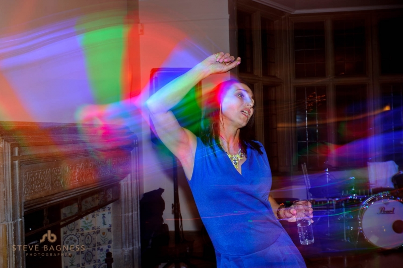 A guest leaves a trail of red and blue lights as she dances