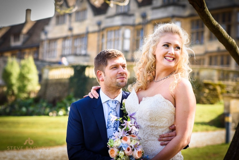 A bride and groom pose for photos at Coombe Lodge Somerset
