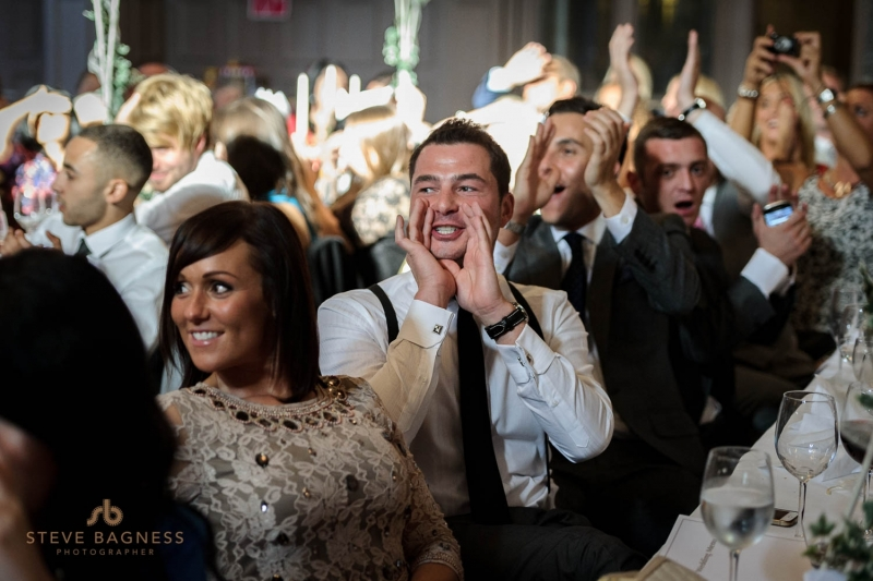Guests cheer and applaud during speeches at aa Harte And Garter Hotel wedding